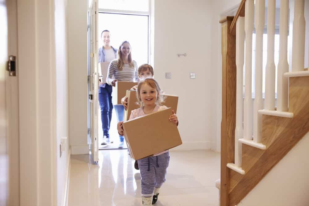 kids-and-adults-walking-with-boxes