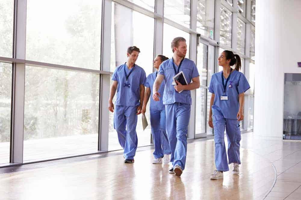 Doctors walking down hospital hallway